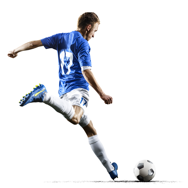 Professional football soccer player in action on white background